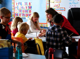 Fraser Valley Elementary School second grade teacher Lindsay Jarzynka works with her students on Tuesday, Jan. 14, in Fraser.