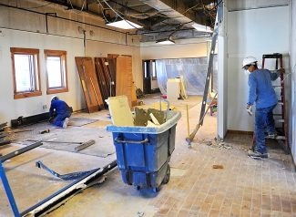 Crews work on removing material from the East Grand Fire Station on Thursday, March 13, in Fraser.  The station is undergoing an extensive remodel, which should be completed by July.