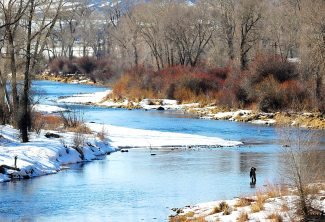 A fisherman takes advantage of the mild weather to test the waters of the Colorado River west of Parshall on Wednesday afternoon, March 5. Snow is likely today followed by mild weather through the weekend.