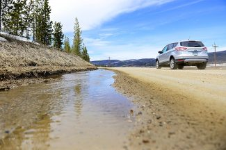 Melting snow flows in a ditch along County Road 83 near Tabernash on Thursday, April 24. The high snowpack this year has the potential to create flooding and erosion problems.