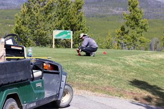 Grand Lake Golf Course worker Patrick Thomas on May 21 prepares tee box No. 3 in preparation for opening weekend. Grand Lake Golf and Pole Creek Golf are scheduled to open on Friday, May 23; Grand Elk opened on May 16, seven days a week; and Granby Ranch opened May 19, seven days a week.