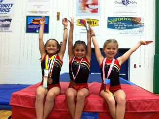 State champions in gymnastics at this year's CARA competion, Level 4, from left, Lorissa Mero, Rosie Walker and Olivia Maurauas.