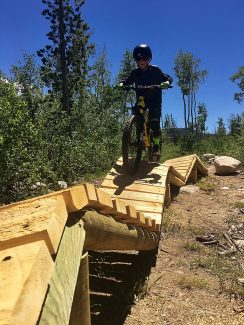 Asher Michels, 10 navigates the new trail structures built by the Town of Winter Park.