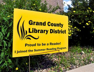 Participants in the Grand County Library District's popular summer reading program receive free yard signs declaring their commitment to a summer of reading.  Byron Hetzler/Sky-Hi News