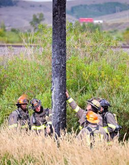 Granby fire fighters examine a utility pole that was struck by lightning on Sunday afternoon, Sept. 8, along U.S. 40 west of Granby.