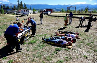 """Grand County EMS personnel, along with East Grand Fire and Fraser/Winter Park Police, assist the """"victims"""" during a mass casualty exercise on Tuesday morning, Sept. 17, at the John Work Arena in Fraser.  The scenario involved 26 victims of a campfire that got out of control when gasoline was poured on it.  Additional agencies and facilities participating in the drill included Denver Health East Grand Clinic, Denver Health Hospital, Middle Park Medical Center Granby, Grand County Sheriff's Office, Winter Park Resort, Grand County Public Health, Middle Park High School, West Grand High School, local Boy Scouts, Foothills RETAC, University Hospital, North Colorado Medical Center and Colorado Plains Hospital."""