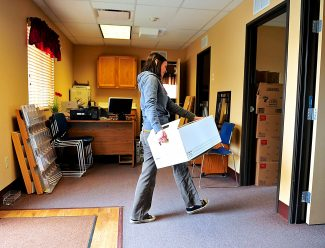 Mandi Appelhans moves files into the new location for the Mountain Family Center in Granby on Thursday, Oct. 17.