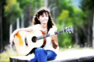 Fraser resident Retta Yarbrough plays Music on the Mall in Winter Park.