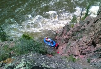 Rescue personnel from Grand County Search and Rescue and the BLM rescued a 21-year-old woman who had spent the night on a ledge above a Class III rapid on the Colorado River Thursday, June 5. All five occupants were ejected from their raft at Yarmony rapid at 6:20 pm on Wednesday, June 4, all but the recued subject made it back to the raft. Efforts to find the woman Wednesday night proved fruitless. She was located just after 10 a.m. on Thursday stranded on the ledge surrounded by sheer cliffs on one side and the Colorado River on the other.  Rescue crews traversed steep terrain above the subject and rappelled one rescuer down to her. The subject was cold and exhausted from her ordeal, but uninjured. She had lost her shoes.