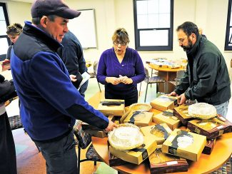 Shoppers pick out pies during last year's pie sale. The 11th Annual Thanksgiving Holiday Pie Sale will be held Tuesday, Nov. 26, at the Grand County Administration Building in Hot Sulphur Springs.  The event is a fundraiser for the Hot Sulphur Springs Library.