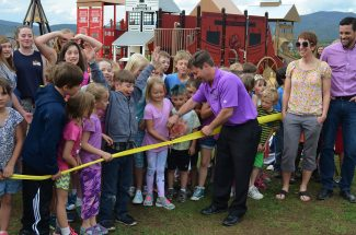 Scott Ledin cuts the ribbon with many local children for the new playground at the Fraser Valley Sports Complex. The Fraser Valley Rec hosted a Grand Opening and Ribbon Cutting on Thursday, June 9.