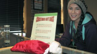 Alternative Medical Solutions employee Valerie Arenivar gets into the holiday spirit at the recreational marijuana store, which offered a few Christmas specials for shoppers this week.