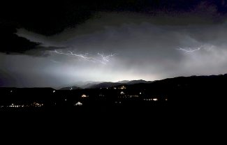 A thunderstorm that put on a spectacular lightning show moves over Rocky Mountain National Park on Tuesday evening, Aug. 27, as seen from Granby.  The storm knocked out power from Granby to Grand Lake.