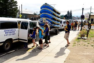 Rafters load into vans at Adventures in Whitewater in Kremmling on Thursday morning, July 17, as they prepare to head to the Colorado River for a day of rafting.