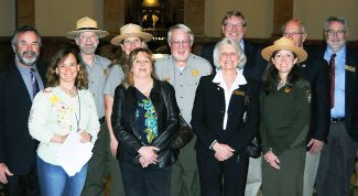 Several officials from Grand County attended the state legislature and its resolution honoring the Rocky Mountain National Park for its 100-year annivarsary. Among them are Grand Lake Mayor Judy Burke, Grand County Commissioner James Newberry, and Grand Lake Trustee Kathy Lewis, alongside Rocky Mountain National Park Superintendent Vaughn Baker and several Park administrators, as well as officials from Estes Park.