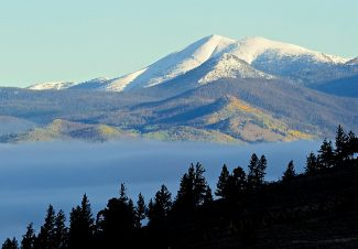 The Never Summer Range rises above a layer of fog over Granby on Tuesday morning, Sept. 24