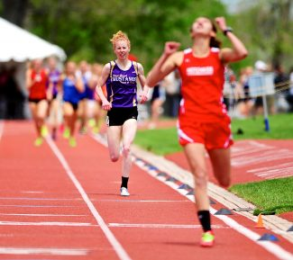 West Grand's Tabor Scholl finishes second behind Hotchkiss' Jennifer Celis in the 2A girls 800-meter run at the Colorado High School State Track & Field Championships on Friday, May 16, at Jeffco Stadium in Lakewood.