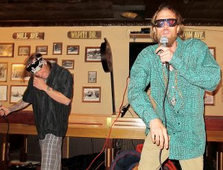 "Local hip-hop artist Parker Thomson (right) and backup singer Ryan Arnold (left) kicked things up a few notches at the Crooked Creek Saloon's Open Mic Night Thursday, June 9. Thomson is currently finishing album ""Avalanche"" and several songs can be heard on SoundCloud."