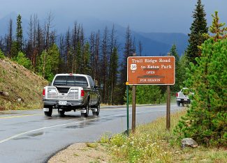 Vehicles travel toward the entrance station in Rocky Mountain National Park after Trail Ridge Road and the park was reopened to the public on Wednesday morning, Sept. 18.