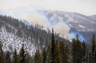 Smoke rises from slash piles on Tunnel Hill between Winter Park and Winter Park Resort on Tuesday, Nov. 5.  The U.S. Forest Service has an estimated 20,000 piles to burn in the 400-acre area.  Burning is expected to continue through the end of the year as conditions permit.