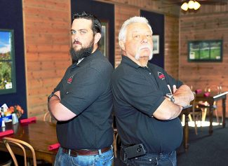 Sean Richardson, left, and Bill Edelstein will once again battle in a Waiter War at Maverick's Grill on Saturday in Granby to raise money for the Granby Rotary.