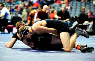 Middle Park's Adam Visconti, top, wrestles Nate Henry of Alamosa in the 152-pound 3A quarterfinals at the Colorado State High School Wrestling Championships on Friday morning, Feb. 21, at the Pepsi Center in Denver. Visconti went on to win 11-2 and advance to this evening's semifinal where he will face Elias Altimarano of La Junta.
