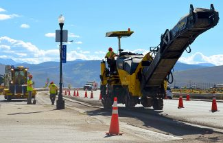A Colorado Department of Transportation (CDOT) work crew was hard at work Monday morning on US Highway 40 in Granby, just west of the train tracks overpass, conducting milling and filling work. The CDOT crew was milling down old material and potholes and refilling with new asphalt material.
