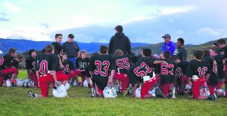 The East Grand Middle School Cubs football team listens to a few final points from Head Coach Darrell Woods (center standing) after a recent practice in Granby. The Cubs' last game of the season will be held on Oct. 1.
