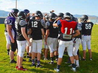 Football players from Middle Park close out afternoon practices in Granby with a quick huddle on Wednesday August 31. The Panthers will compete against the Estes Park Bobcats for the Trail Ridge Trophy on Friday September 2.