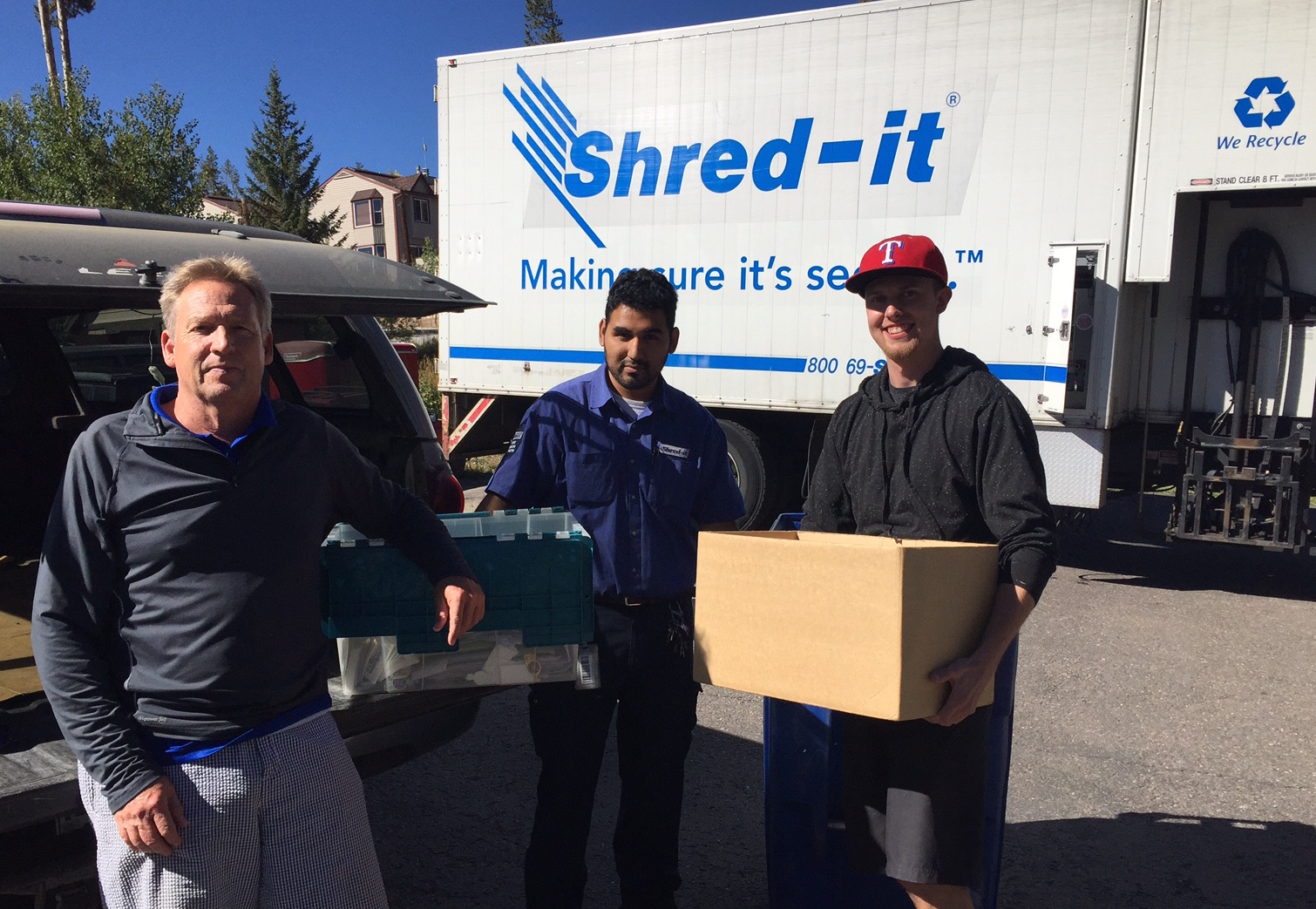 Don Dreher of Fraser, Sam Marquez from Shed-It and Jordan Miller of Real Estate of Winter Park help unload documents to be shredded during the Free Community Shred-It event at the offices of Real Estate of Winter Park.