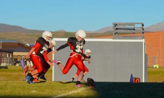 East Grand Middle School eighth-grader Katie MacKendrick kicks off during a Cubs football came against Soroco, from southern Routt County, on Tuesday Sept. 27. MacKendrick serves as the Cubs eighth-grade team kicker and scored the first ever PAT kick and field goal kick in EGMS history.