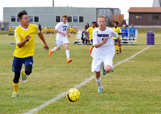 Middle Park's junior mid-fielder Lukas Senovaitis sprints across the pitch to take posession of the ball during Middle Park High School's soccer match against the KIPP Denver Collegiate High School last Wednesday, Sept. 14.