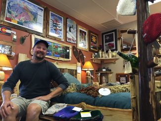 Rob Peeters in his store, Naked Aspen Designs in Fraser on Wednesday, August 31. He is sitting on his reengineered, minimalist bed.