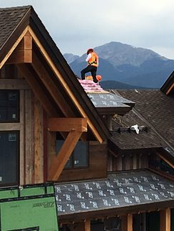 An unidentified worker scales the heights of new construction in Rendezvous in Fraser. Reader submitted photo by Julianne Eichler of Granby.