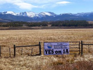 Board members of the Colorado Headwaters Land Conservation Trust put up a special banner along US Highway 40 in Tabernash supporting