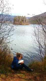 Indian Peaks student Juliette Stauffer reads a book on the shores of Shadow Mountain Lake in the Pine Beach area on Friday Oct. 14 during a recent Indian Peaks Outdoor Education, Wellness and Leadership (OEWL) Program event.