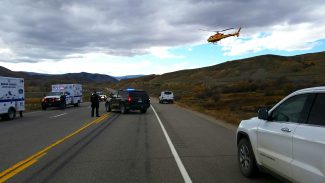 A Flight for Life helicopter swoops in for a landing on US Highway 40 after an electric lineman from Mountain Parks Electric was severely shocked Wednesday afternoon.