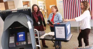 Grand County election judges Lynnae Boyd (right), Maralyn Branstetter (center) and Jen Scott (right) review election equipment and procedures at the Grand County Courthouse on Wednesday, October 19.