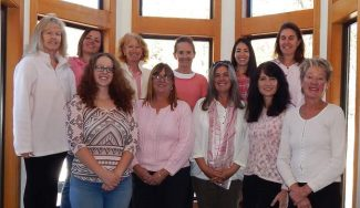 """The Staywinterpark team showcases """"pink"""" in support of Breast Cancer Awareness for the month of October. Back row:  Katherine Gates, Shannon Cormier, Maggie Lore, Peggy Davenport, Pamela Flor-Stout, Erika Schwankl"""