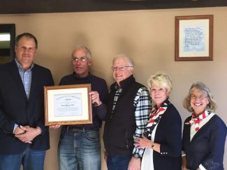 The Celebration of the  Colorado Pilots Association Outstanding Airport Award for Granby/Grand County Airport-Emily Warner Field on November 11. Only one award of a non-commercial airport is honored in the state each year. From the left; Grand County Commissioner Merrit Linke, Experimental Aircraft Association Chapter 1267 Vice President Dick Sunderland, Grand County Historical Association President Dan Nolan, Main Street and Events Coordinator Gayle Langley, Greater Granby Area Chamber of Commerce Executive Director Cathie Hook.