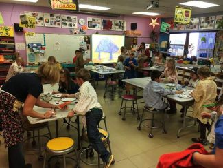 Fraser elementary school artists work to create masterpieces that will help people and animals in Grand County.