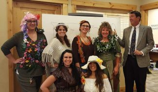Grand Mountain Bank Granby staff dress in Halloween costume. They are  the five seasons of Grand County. Winter, Spring , Summer, Fall  and mud season. Along with Mother nature and  the Weatherman.