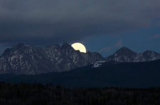 """Super Moon"" rises over the Indian Peaks near Winter Park on Sunday, November 13, 2016. The last time a full moon was this close to Earth was 68 years ago and according to the US Census, less than 10 percent of today's US population was alive to see it. NASA says that ""a supermoon can appear as much as 14 percent bigger and 30 percent brighter than the average full moon"" and ""it'll be another 18 years before the full moon gets this close to Earth again""."
