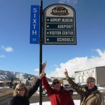 Granby Rotary members proudly point to the new Airport Museum Wayfinding sign at the corner of 6th and Agate in historic downtown Granby underwritten by Rotary members. From the left; Susie Baird, Club President, Tom Chaffin, Rotary member and Emily Warner Field Aviation Museum volunteer, and Wayne Balnicki, Rotary Treasurer.