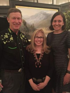 """Governor John Hickenlooper, artist Karen Vance and First Lady Robin Hickenlooper stand in front of Vance's oil painting at the """"Boots and Brushes Gala"""" at the Governor's Mansion on Nov.16. The painting, """"High Country Autumn- Rocky Mountain National Park"""", a 26"""" x 36"""" oil painting was purchased by The Governor's Residence Preservation Fund for the Mansion's Art Collection. Vance painted this specifically for the Governor's mansion."""