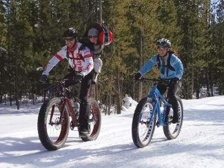 Fat bike enthusiast Jim Simmons with Headwaters Trails Alliance Director Meara McQuain enjoying the day on D2.