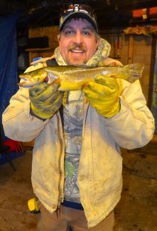 Eric Lawing displays the fish he submitted for measurement early Friday morning.