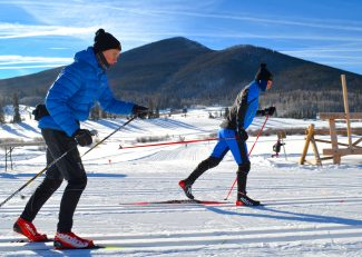 A pair of cross-country skiers warm up on the classic track at Snow Mountain Ranch Saturday morning Jan. 7 in preparation for races later in the morning.