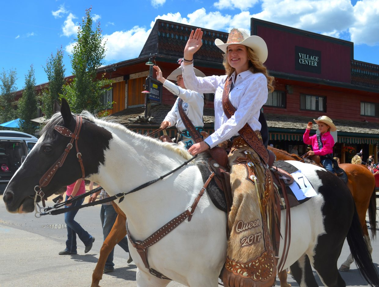 Rodeo Royalty make their way down Grand Avenue.