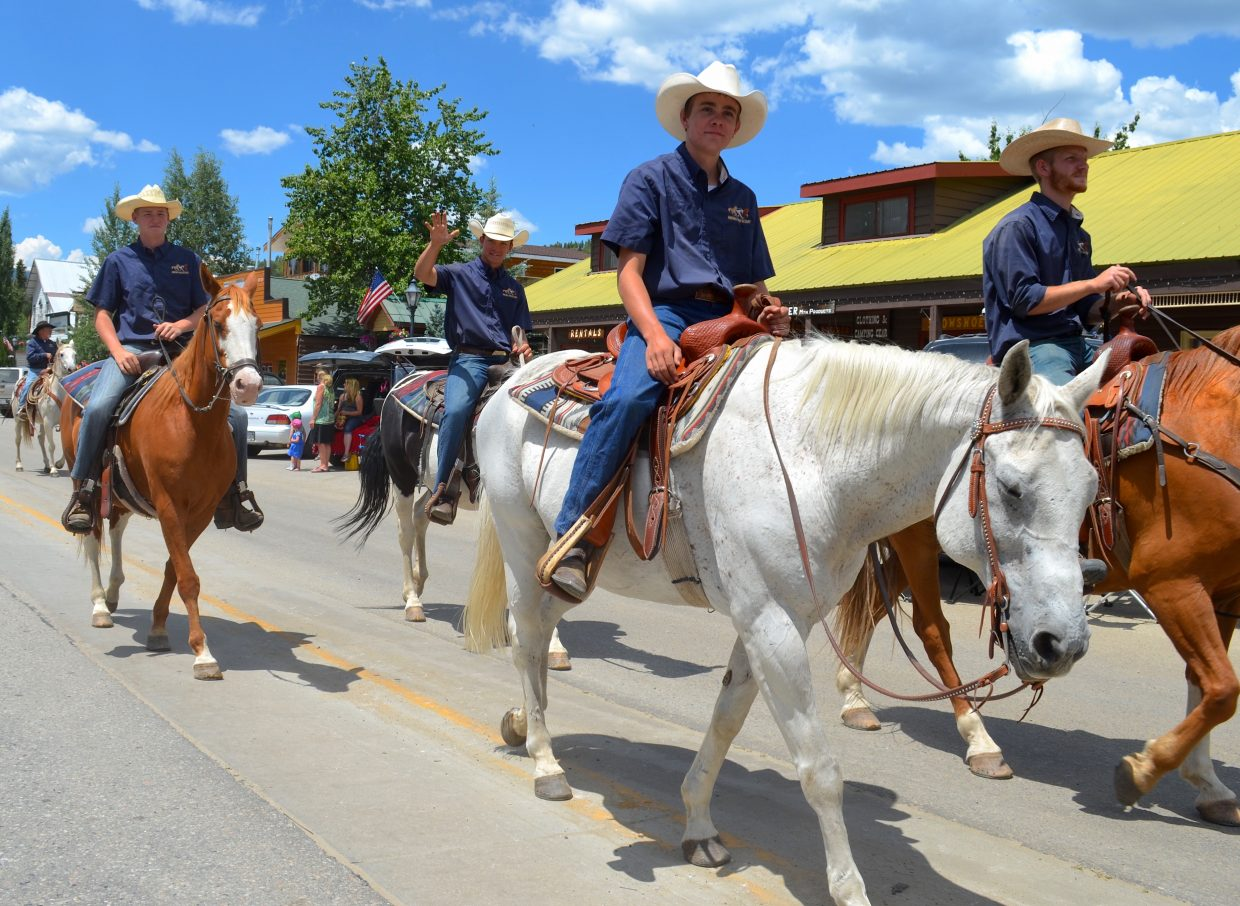 Riders from Winding River Resort, just outside of Grand Lake proper, work their way down Grand Avenue on July 16.